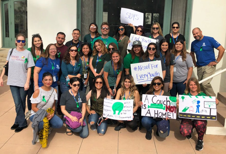 Staff at Rally for Homeless Youth Awareness Month