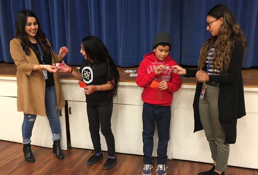 SDYS staff giving youth gift cards
