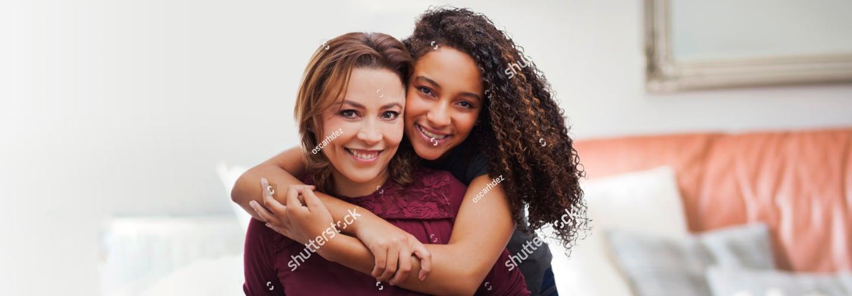 Parent and teen girl