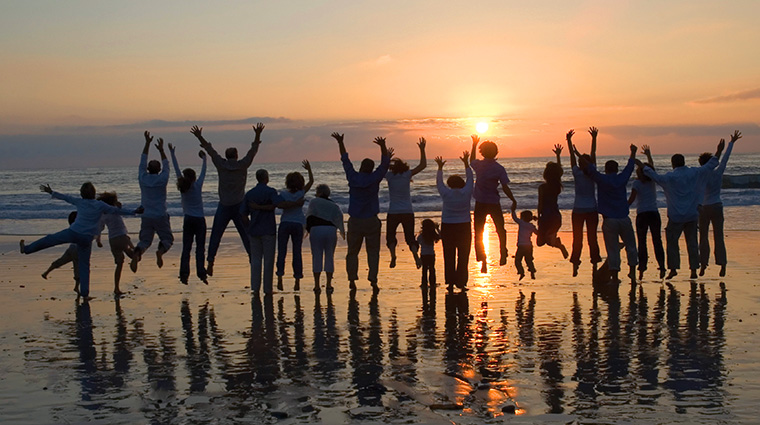 Happy people jumping at the beach