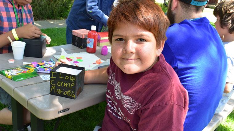 Youth doing crafts at Camp Mariposa